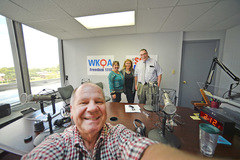 Photographers Harry Gerwien and Erin Clark join Nora Firestone and Larry Cobb at WKQA studio.